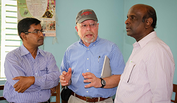 Tony Shelton (center) talks with Md. Rafiqul Islam Mondal (right), director general of BARI, about the bt eggplant project.   CREDIT: A. Hossain