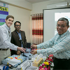 US Ambassador Earl Miller exchanges goodwill with Dr. Gobinda Chandra Biswas, Chief Scientific Officer BARI, (left) and Dr. Md. Jahangir Hossain, Country Coordinator, FTFBP.